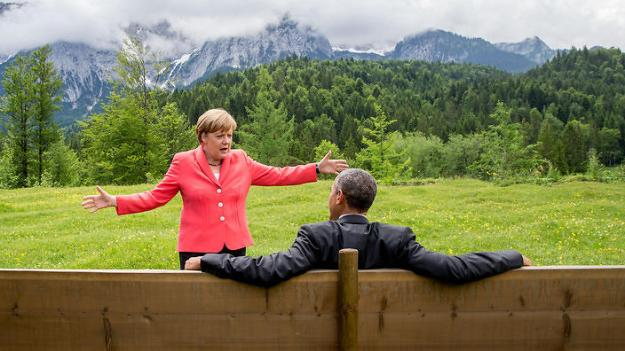 Merkel tells Obama about the size of the problem (against a 'hey, the climate looks effing good to me' background)